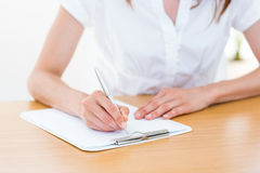 Businesswoman taking notes. On white background Stock Images