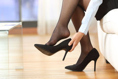 Businesswoman Taking Off Shoes Stock Images