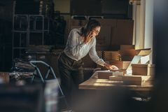 Businesswoman taking order over phone stock photography