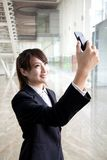 Businesswoman taking picture by camera p Stock Photos