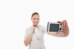 Businesswoman taking a picture of herself Royalty Free Stock Images