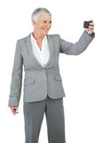 Businesswoman taking picture of herself Royalty Free Stock Images