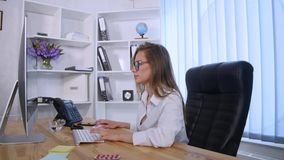 Businesswoman taking pill during work with documents in office Stock Photo