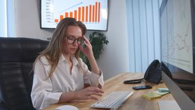 Businesswoman taking pill during work with documents in office Royalty Free Stock Photography
