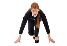 Businesswoman taking position for a sprint Royalty Free Stock Image