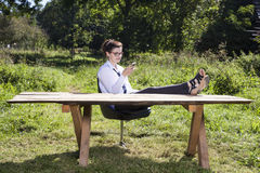 Businesswoman taking a rest from everyday life Stock Photography