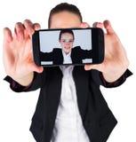 Businesswoman taking a selfie on smartphone Stock Photo