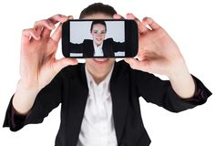Businesswoman taking a selfie on smartphone Stock Image