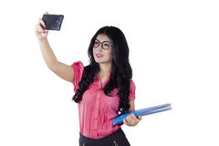 Businesswoman taking selfie in studio Stock Image