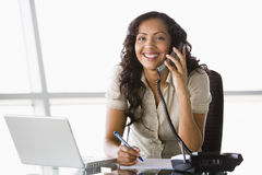 Businesswoman taking telephone call Royalty Free Stock Images