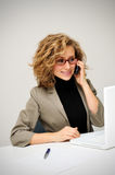 Businesswoman taking telephone call. In office stock photography