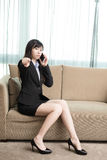 Businesswoman talk on phone. Business woman pointing you and talk on phone Stock Images
