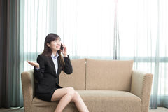 Businesswoman talk on phone. Business woman smile happily and talk on phone Stock Photography