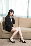 Businesswoman talk on phone. Business woman smile happily and talk on phone Royalty Free Stock Photos