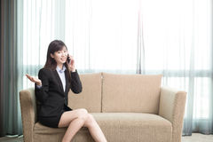 Businesswoman talk on phone. Business woman smile happily and talk on phone Royalty Free Stock Images