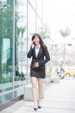 Businesswoman talk on phone. Business woman smile happily and talk on phone Stock Photo
