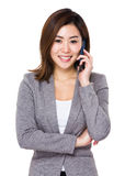 Businesswoman talk to cellphone Stock Images