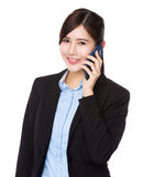 Businesswoman talk to cellphone Stock Photography