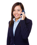 Businesswoman talk to cellphone Stock Photo