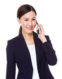 Businesswoman talk to cellphone Royalty Free Stock Images