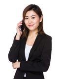 Businesswoman talk to cellphone Stock Photo