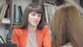 Businesswoman talk to a customer during consulting in a fashion in office. Businesswoman consulting buyer and urges to buy a product stock footage