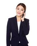 Businesswoman talk to mobile phone Royalty Free Stock Images