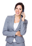 Businesswoman talk to mobile phone Stock Image