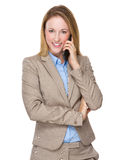 Businesswoman talk to mobile phone Stock Photography