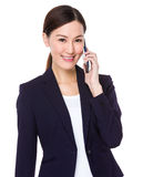 Businesswoman talk to mobile phone Royalty Free Stock Photo