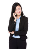 Businesswoman talk to mobile phone Stock Photo