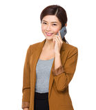 Businesswoman talk to mobile phone Royalty Free Stock Photos