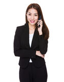Businesswoman talk to mobile phone Royalty Free Stock Photography