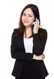 Businesswoman talk to mobile phone Stock Images
