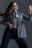Businesswoman talk to mobile phone in studio Stock Photos