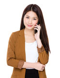 Businesswoman talk to phone Stock Photography
