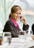 Businesswoman talking on cell phone Royalty Free Stock Images