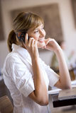 Businesswoman talking on cell phone in cafe Stock Images