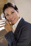 Businesswoman talking on cell phone outdoors Royalty Free Stock Images