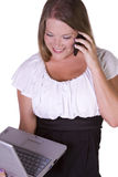 Businesswoman at Talking on the Cell Phone at Work Royalty Free Stock Image