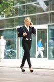 Businesswoman talking on cellphone in the city Royalty Free Stock Photo