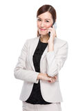 Businesswoman talking by cellphone Stock Photo
