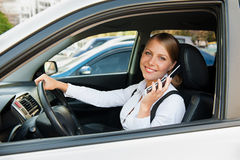 Businesswoman talking on the cellphone and parking Stock Images