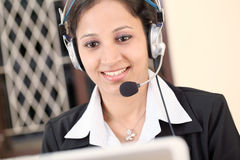 Businesswoman talking with clients Stock Photography