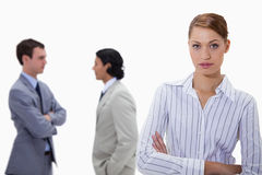 Businesswoman with talking colleagues behind her Royalty Free Stock Photo