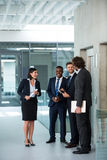 Businesswoman talking with colleagues Stock Image
