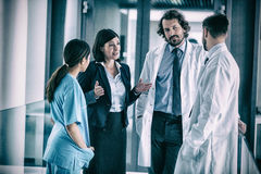 Businesswoman talking with doctors. In hospital royalty free stock photo