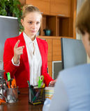 Businesswoman talking with employee Stock Photo
