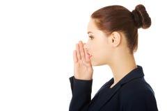 Businesswoman talking gossip Stock Photo