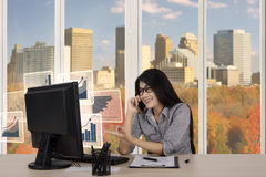 Businesswoman talking growth charts by phone Royalty Free Stock Photo